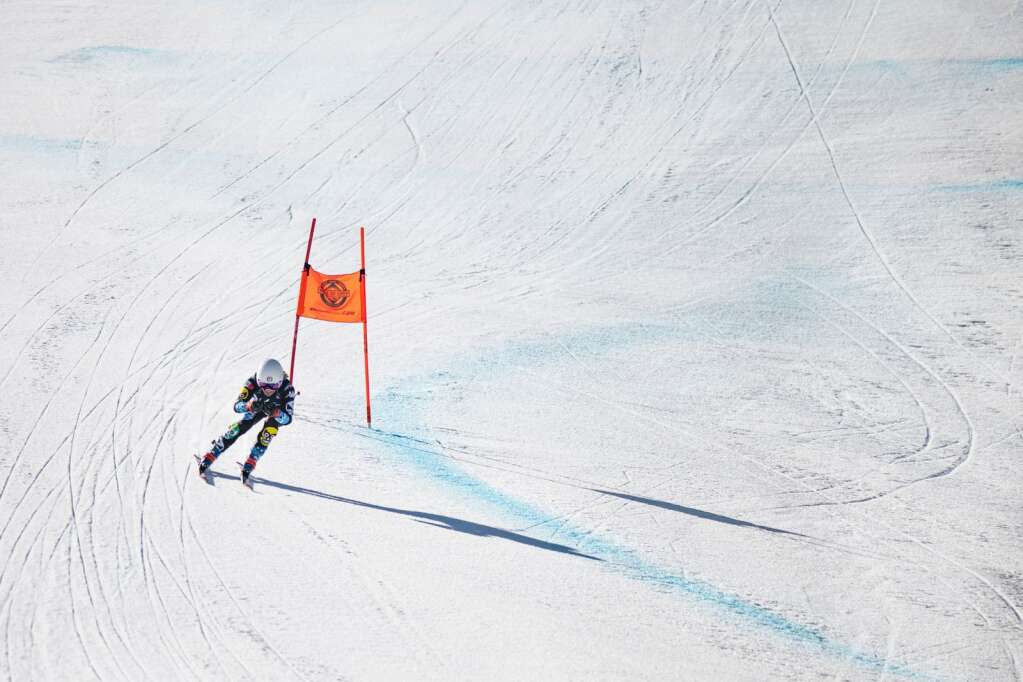 Mexican alpine skier Sarah Schleper makes a final turn on the Women's Downhill National Championship course at Aspen Highlands on Saturday, April 10, 2021. (Kelsey Brunner/The Aspen Times)