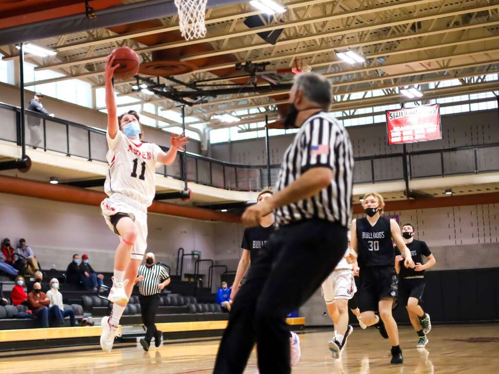 Aspen High School basketball player LIam Farrey goes in for an easy layup against Moffat County on Saturday, March 6, 2021, inside the AHS gymnasium. Aspen won, 68-42. Photo by Austin Colbert/The Aspen Times.
