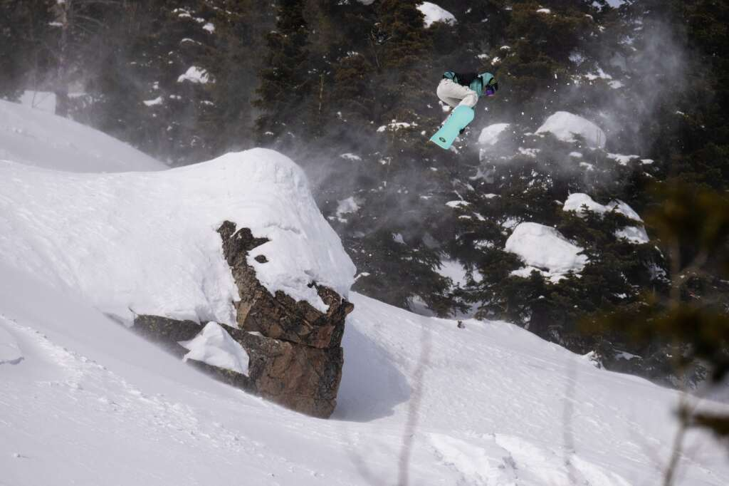 Women's champion Zoi Sadowski-Synnott sends it off a cliff feature during Tuesday's final round of the Natural Selection Tour at Jackson Hole Mountain Resort in Jackson, Wyoming. | Photo by Tim Zimmerman / Red Bull