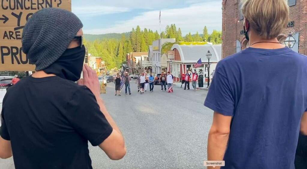 A group of about 80 Black Lives Matter protesters are met by counter-protesters Aug. 9 along Broad Street in Nevada City.   Video still courtesy Josh Wolf