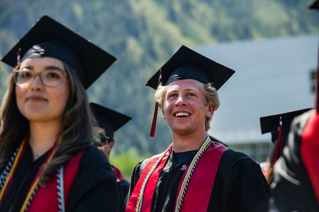 As Aspen High School graduate listens to the speeches during the commencement ceremony in the football stadium on Saturday, June 5, 2021. (Kelsey Brunner/The Aspen Times)