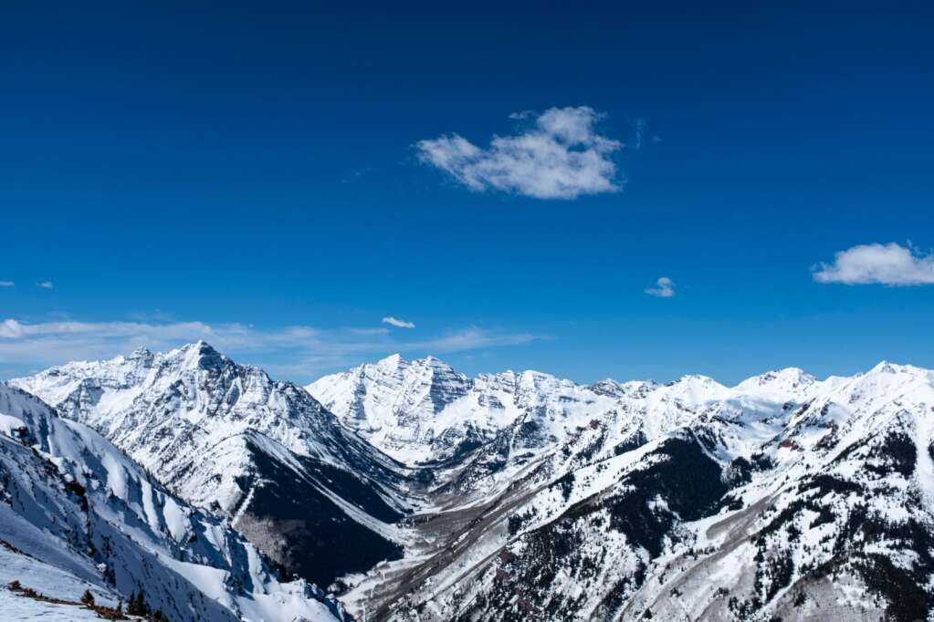 The top of Highland Peak boasts views of Maroon Bells and Pyramid Peak on Wednesday, March 17, 2021. (Kelsey Brunner/The Aspen Times)