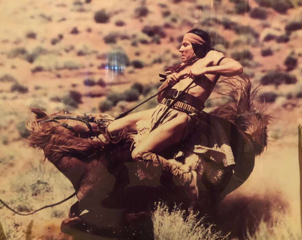 CL Johnson on a movie set with a falling horse, one of his movie stunts. Photo courtesy Josey Johnson