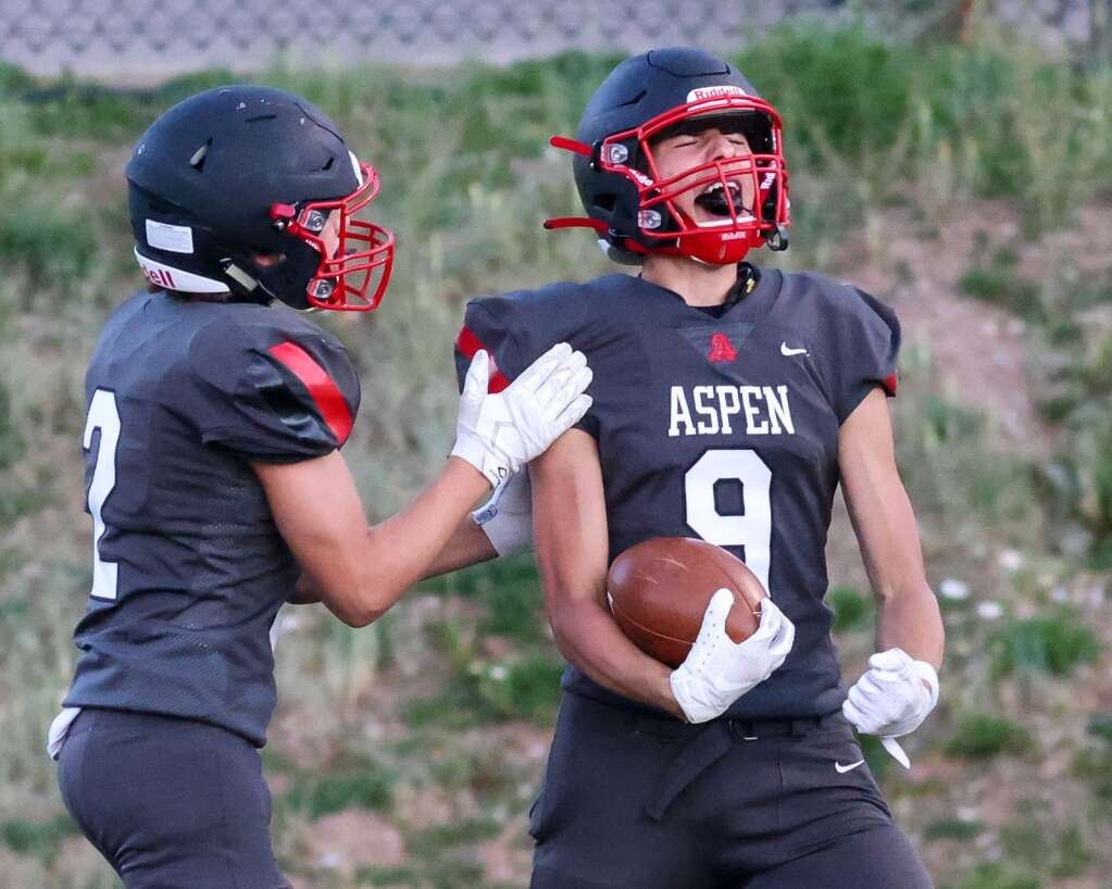 Aspen High School's Porter Lee, right, celebrates a touchdown as the football team hosts Colorado Springs Christian on Friday, Aug. 27, 2021, on the AHS turf. | Photo by Austin Colbert/The Aspen Times