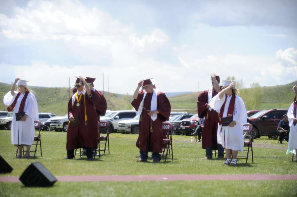 Members of the class of 2021 switch their tassles during the Soroco High School graduation ceremony on Saturday morning.