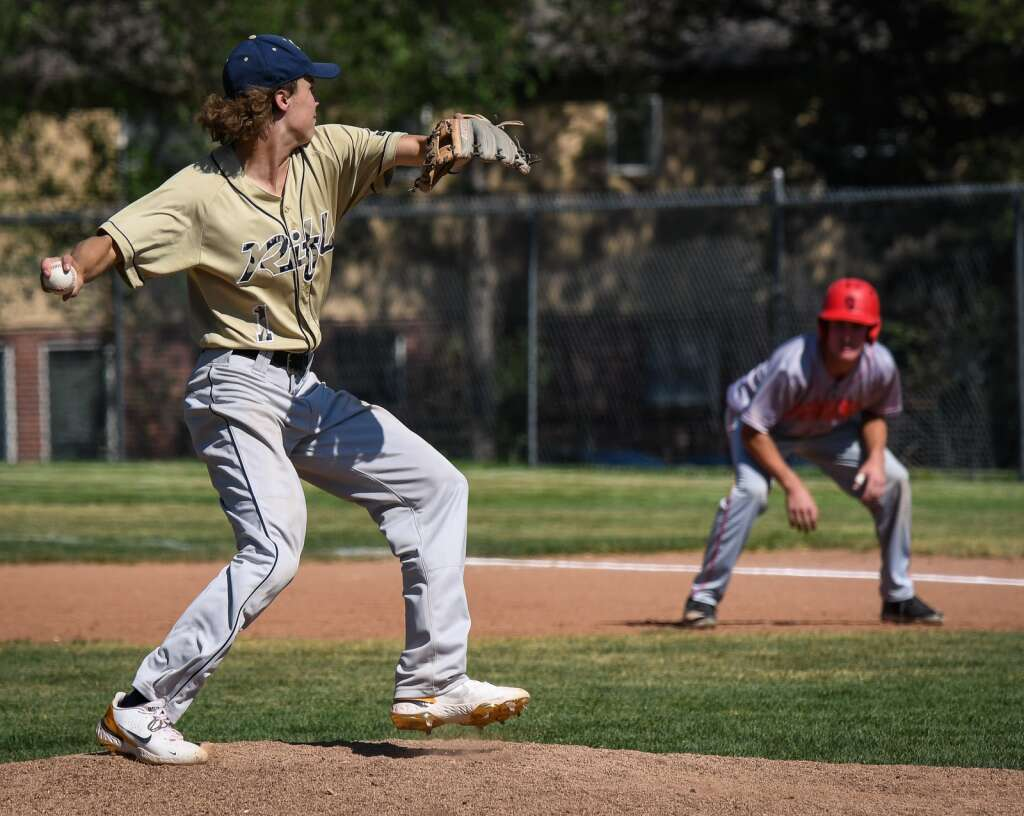 Rifle Bear Austin Bowlan turns to force the runner back to first base during Monday's game against the Glenwood Springs Demons. |Chelsea Self / Post Independent