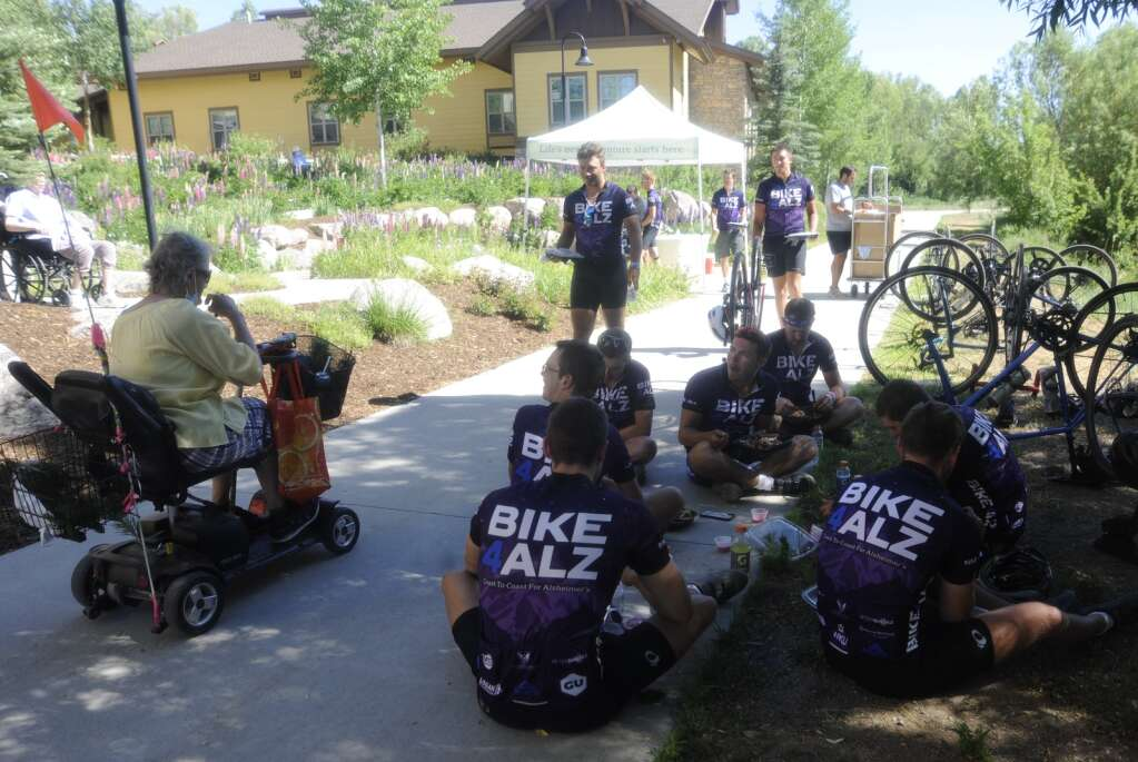 Fourteeen college students who are biking across the country for Bike 4 Alz to raise money for Alzheimer's awareness, stopped at Casey's Pond on Monday. They were treated to a lunch. (Photo by Shelby Reardon)