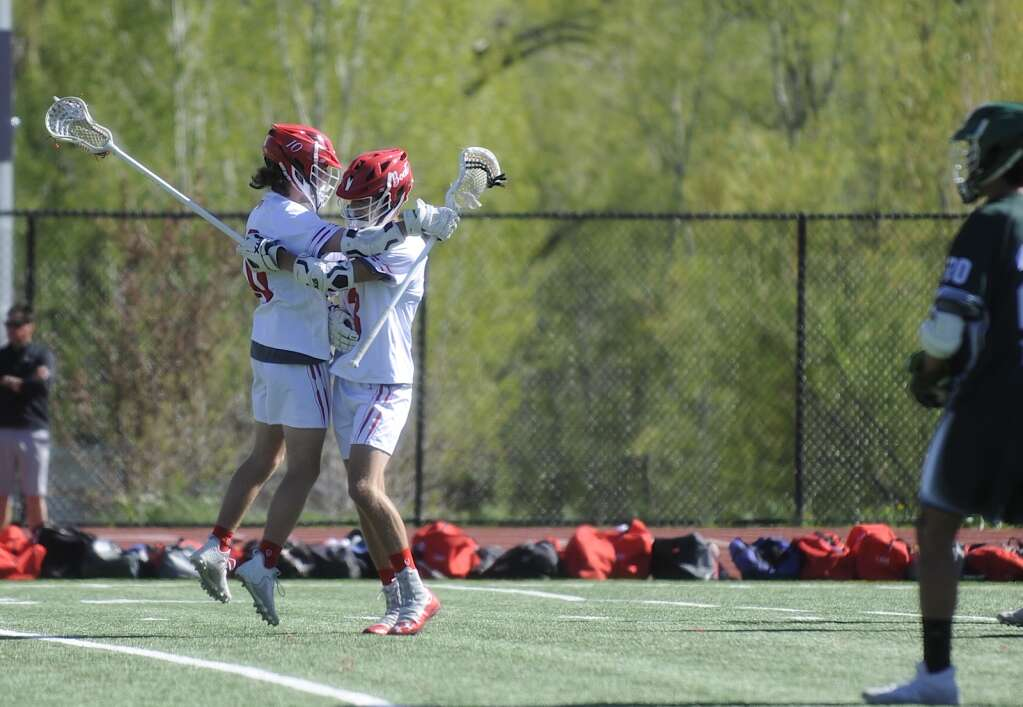 Steamboat Springs boys lacrosse teammates Hayden Magnuson and Ben Schott celebrate Magnuson's goal during a game against Summit on Monday evening. (Shelby Reardon)