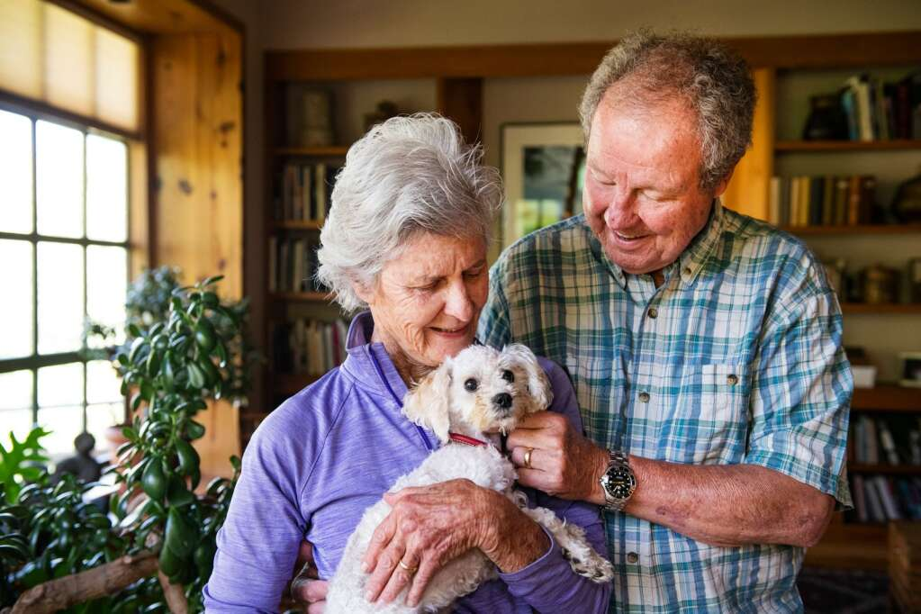 Betsy and Jim Chaffin hold their 10-month-old dog, Bella, in their home on Friday, July 23. Bella was lost in the Maroon Bells-Snowmass Wilderness Area for a month and was found after the community rallied together to help track her down.   Photo by Kelsey Brunner / The Aspen Times