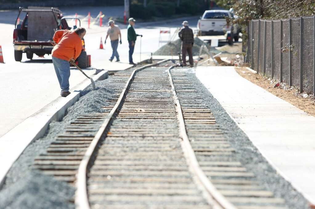 A 300 foot section of narrow gauge rail is laid down by the Narrow Gauge Railroad Museum volunteers along Sacramento Street. A display car has since been placed on the track. | Photo: Elias Funez