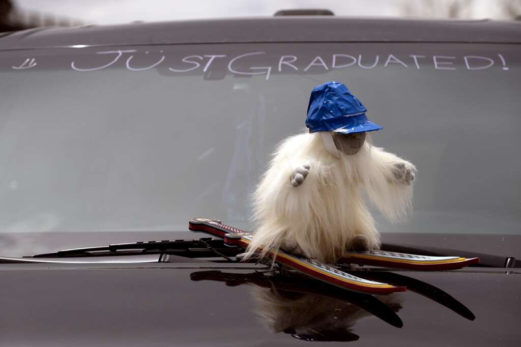 A small yeti figure, the Snowy Peaks High School mascot, is placed on the hood of a vehicle during graduation Wednesday, May 26, at the Silverthorne Performing Arts Center in Silverthorne.   Photo by Jason Connolly / Jason Connolly Photography