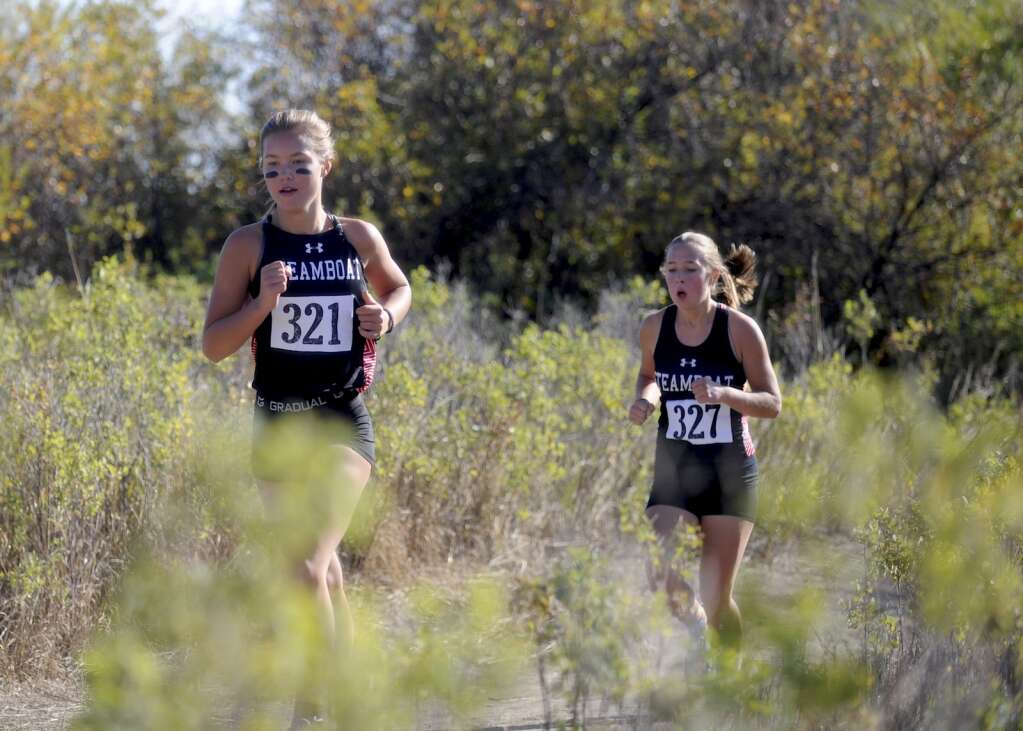 A pair of Steamboat Springs runners settle into a pace at a cross country meet at Loudy-Simpson Park in Craig on Saturday morning.   Shelby Reardon/Steamboat Pilot & Today
