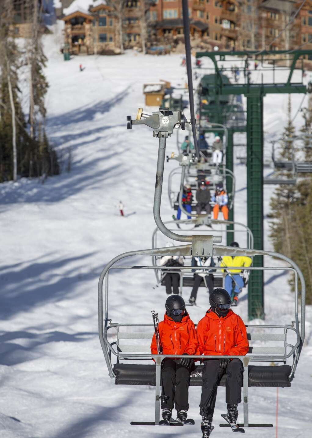 Belinda McConnell, left, and her husband Mike McConnell ski together down Lost Boulder, a blue run off of Flagstaff Mountain at Deer Valley Resort, on Thursday, Jan. 14, 2021. | Tanzi Propst/Park Record