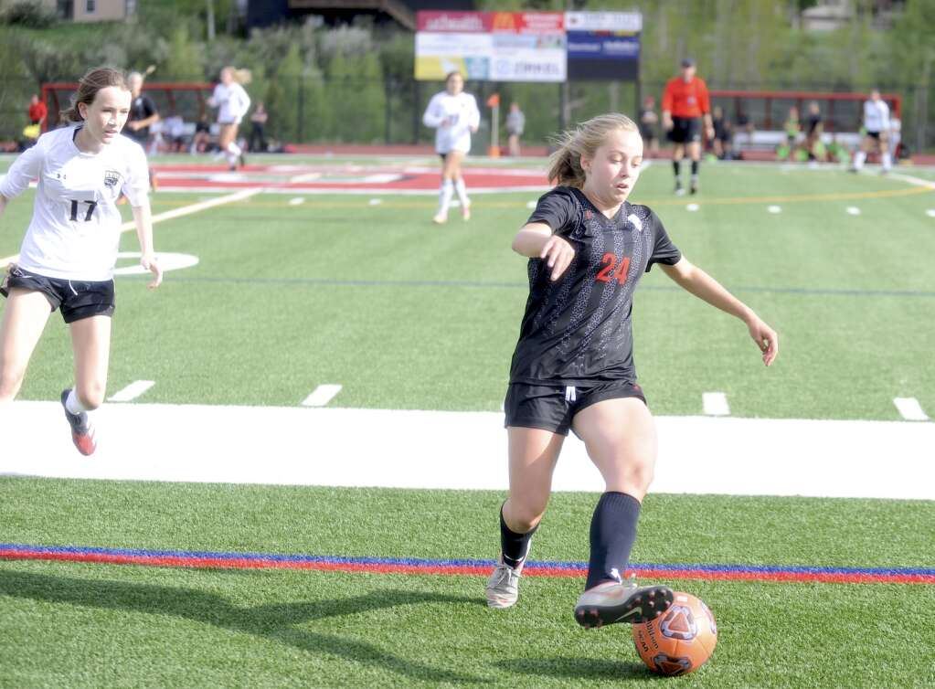 Steamboat Springs soccer player Gwyn Jamison chases after the ball during a game against Battle Mountain on Tuesday night. (Shelby Reardon)