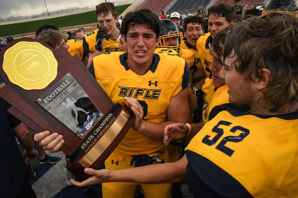 The Rifle Bears celebrate after defeating The Classical Academy 35-34 for the spring 3A state title in Pueblo on Saturday at CSU Pueblo.  |Chelsea Self / Post Independent