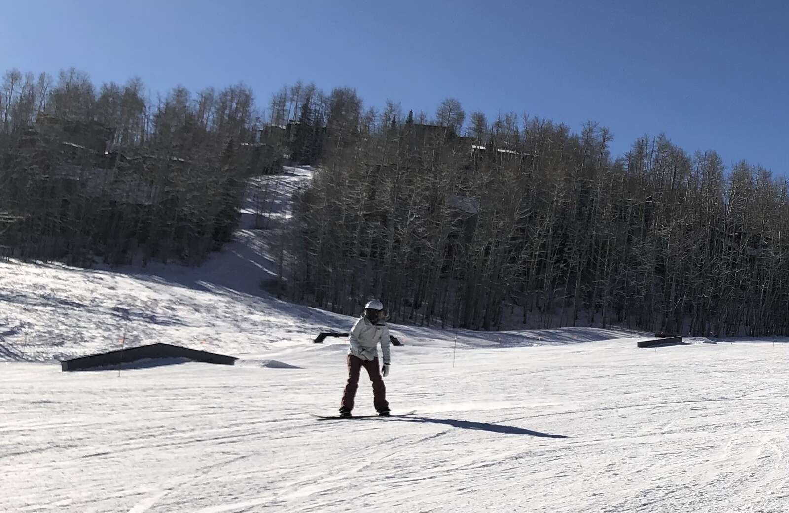 A snowboarder rides down Fanny Hill at Snowmass on opening day, Nov. 25, 2020.