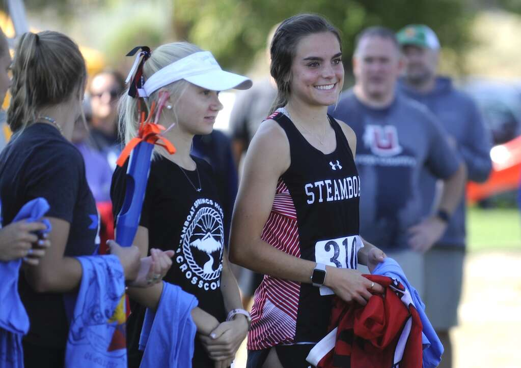 Steamboat Springs junior Autumn Oslowski, left, and senior Caroline Baur finished third and second at a cross country meet at Loudy-Simpson Park in Craig on Saturday morning.   Shelby Reardon/Steamboat Pilot & Today