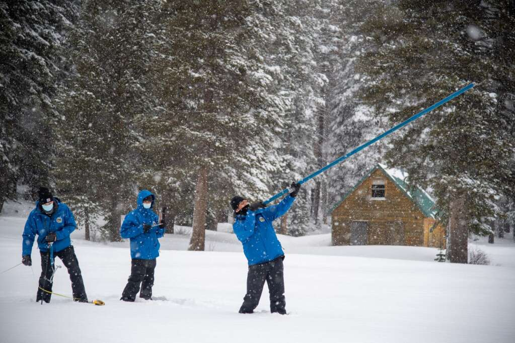 (left to right) Nick Ellis, Electrical Engineer in Statewide Monitoring Network Section, Ramesh Gautam, Chief of California Cooperative Snow Surveys Program, and Sean de Guzman, Chief of the California Department of Water Resources Snow Surveys and Water Supply Forecasting Section, conduct the second media snow survey of the 2021 season at Phillips Station in the Sierra Nevada Mountains. The survey is held approximately 90 miles east of Sacramento off Highway 50 in El Dorado County.  Photo taken February 3, 2021.Florence Low / California Department of Water Resources, FOR EDITORIAL USE ONLY
