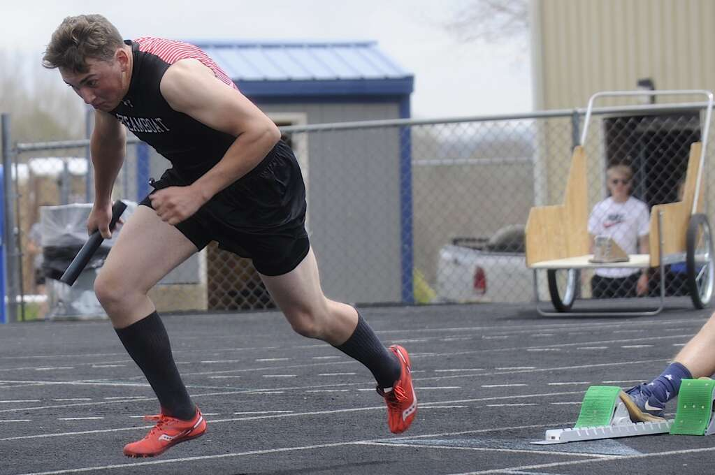 A Steamboat Springs runner busts out of the blocks during the 4x100 at the Clint Wells Invitational in Craig on Friday. (Photo by Shelby Reardon)