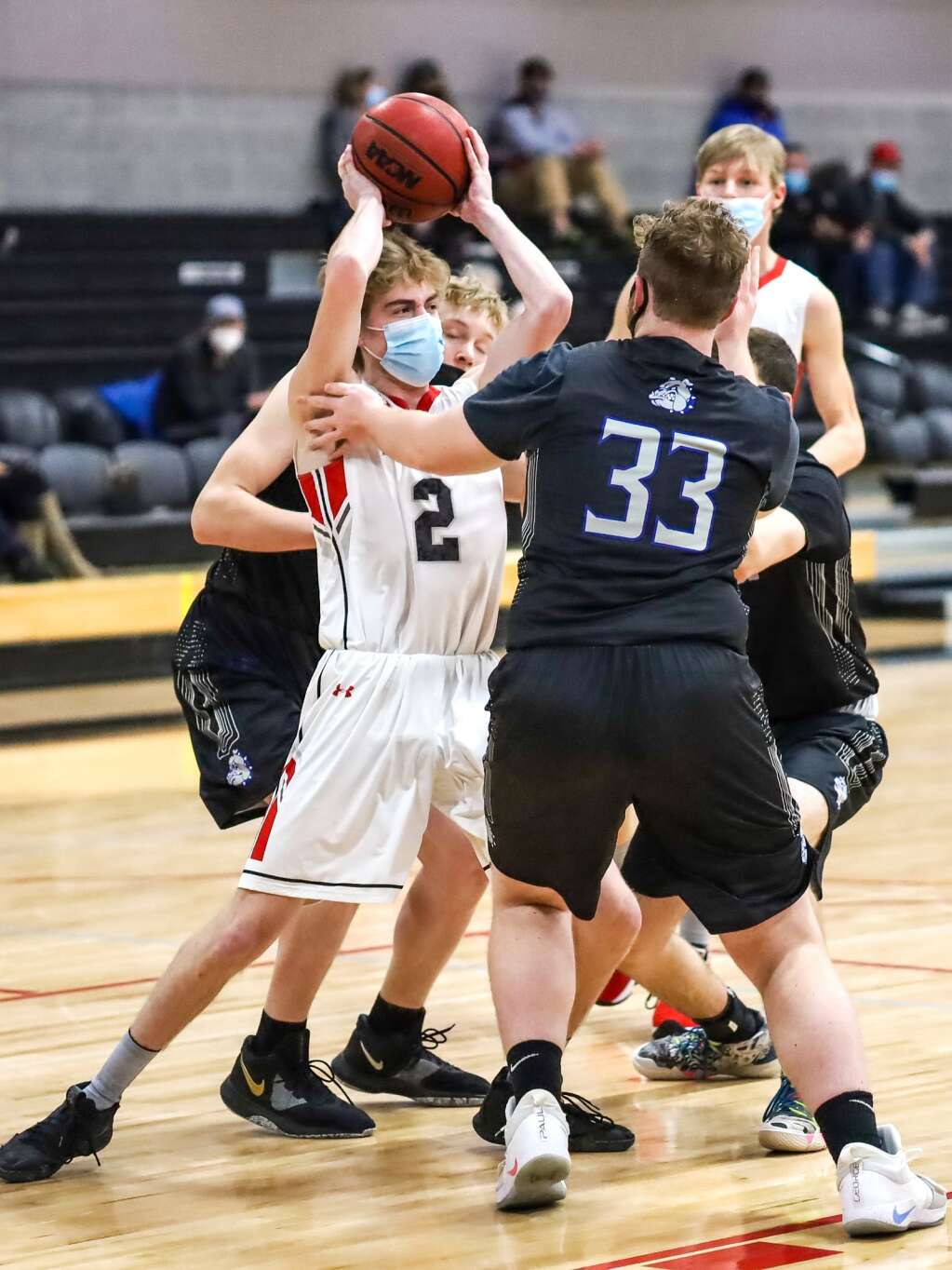 Aspen High School basketball player Luke Hollander is surrounded by Moffat County defenders on Saturday, March 6, 2021, inside the AHS gymnasium. Aspen won, 68-42. Photo by Austin Colbert/The Aspen Times.