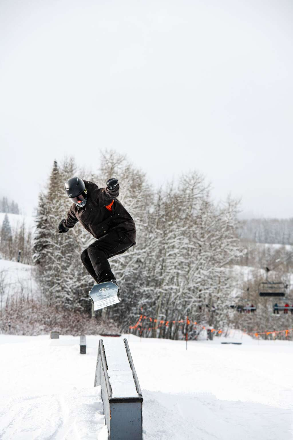 A snowboarder hits a rail at the top of Fanny Hill at Snowmass on a powder day on Tuesday, Dec. 29, 2020. (Kelsey Brunner/The Aspen Times)