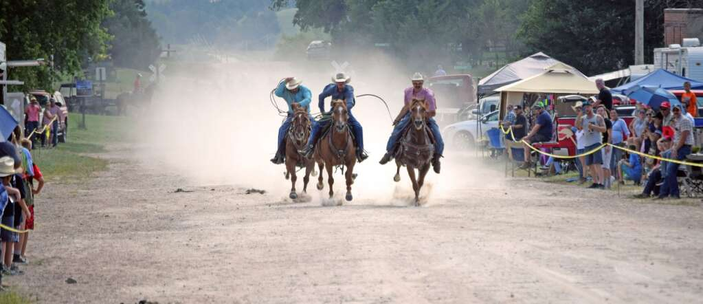 The Wellfleet Horse Races took place in Wellfleet, Neb. after having taken a twelve-year hiatus. The middle cowboy, Casey Durner races with a Marlboro Red in his mouth. On the right is Buck Richards, who won his heat and finished third overall.