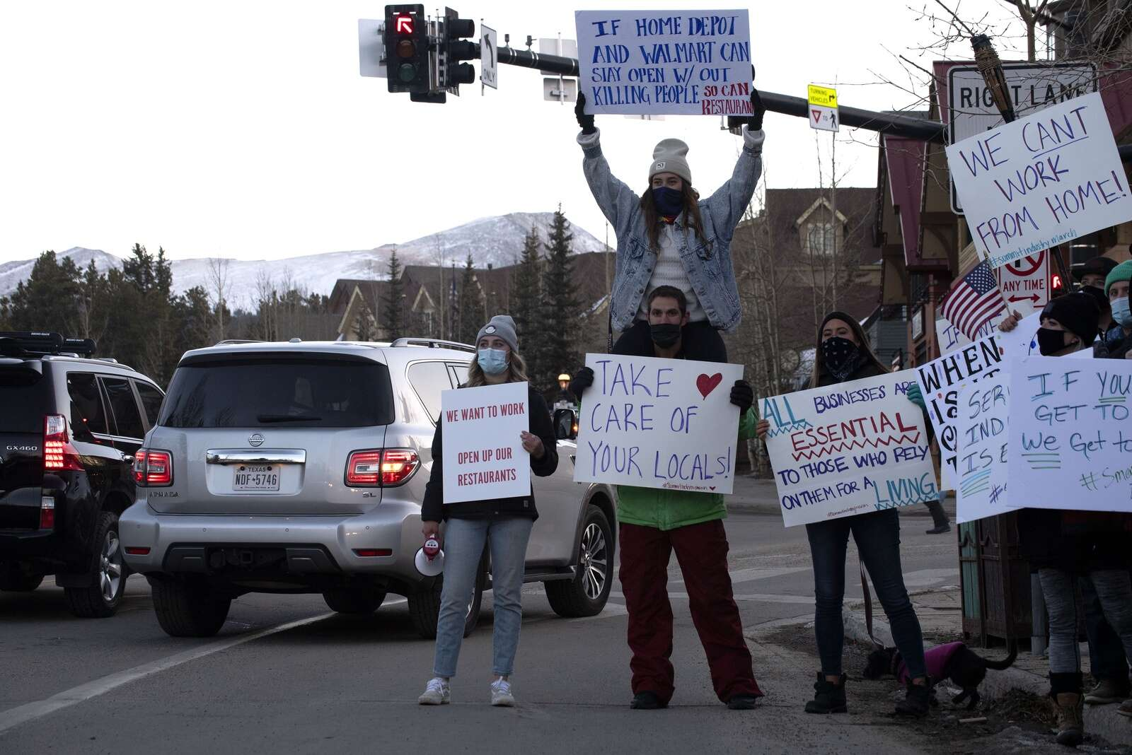 Summit County service industry workers stand at the intersection of Main Street and Park Avenue in Breckenridge on Monday, Nov. 23, while protesting the prohibition of in-person dining at restaurants.