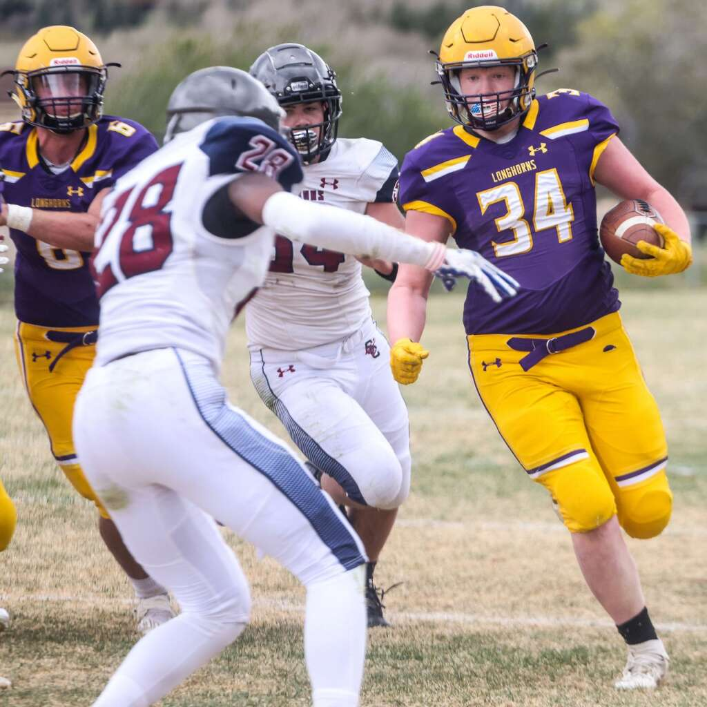 Basalt High School's Cooper Crawford runs against Sand Creek in the Class 3A state quarterfinals on Saturday, May 1, 2021, in Basalt. The Scorpions won, 27-22. Photo by Austin Colbert/The Aspen Times.