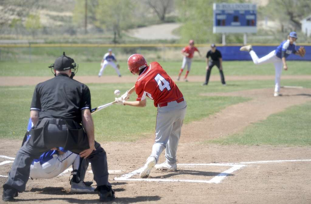 Steamboat Springs baseball player Dawson Holmes makes contact with the ball during a game against Moffat County on Tuesday evening. (Shelby Reardon)