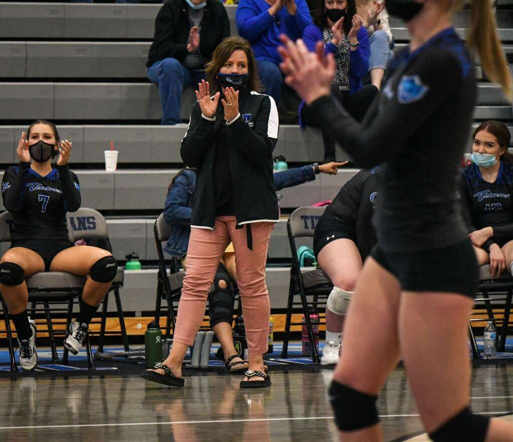 Coal Ridge Volleyball Coach Aimee Gerber cheers on her team during last week's game against Rifle. |Chelsea Self / Post Independent