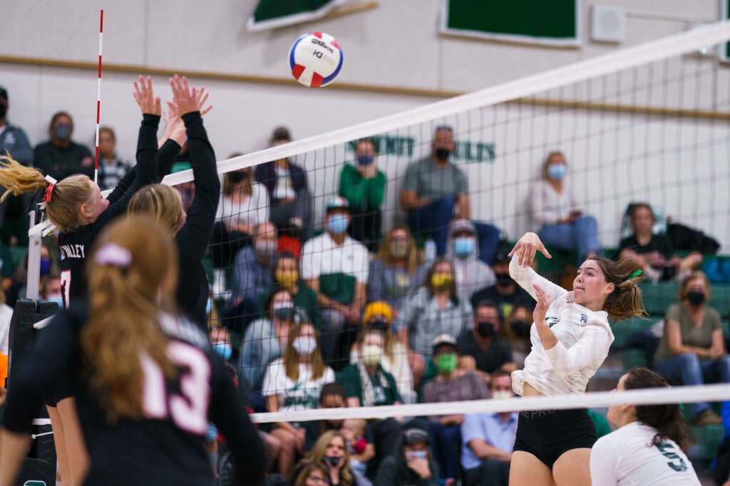 Bella Speer spikes the ball during the second set of the Tigers' home match against the Eagle Valley Devils on Monday, Sept. 20, at Summit High School in Breckenridge. | John Hanson/For the Summit Daily News