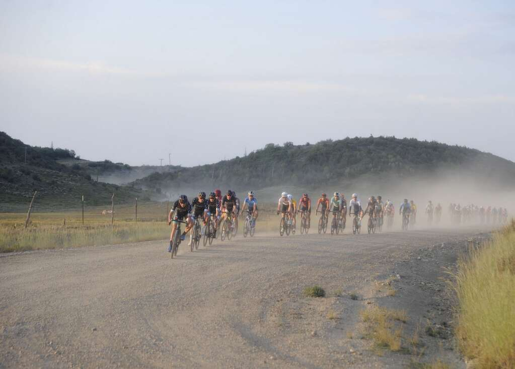 SBT GRVL black course racers turn off of County Road 44A onto CR52E early Sunday morning. (Photo by Shelby Reardon)