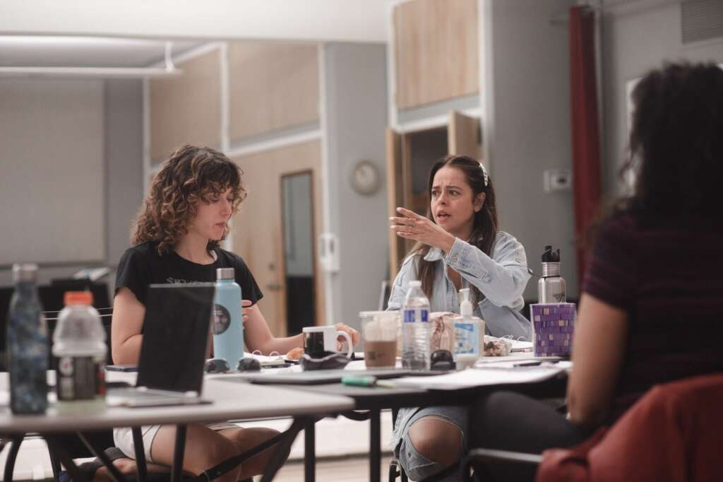 Kate Abbruzzese (left) and Emma Ramos work through a reading of