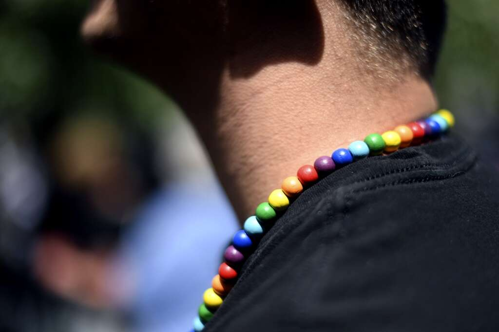 A man wears Pride colored beads while participating in the Pride March in Frisco on Sunday, June 27. | Photo by Jason Connolly/ Jason Connolly Photography
