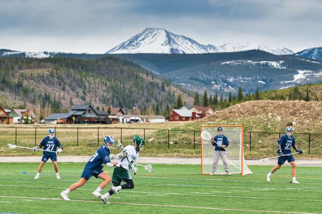 Jagger Koch cradles possession during the Summit High School varsity lacrosse team's loss to Vail Mountain School at Tiger Stadium in Breckenridge on Tuesday. | Photo by Joel Wexler / Rocky Mountain.Photography
