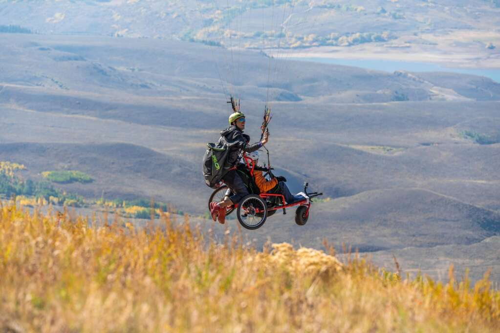 Charlie Martin launches the Project Airtime tandem adaptive wheelchair on a flight Sept. 25 from Williams Peak with passenger Teri Walker. | David Cudd/Courtesy photo