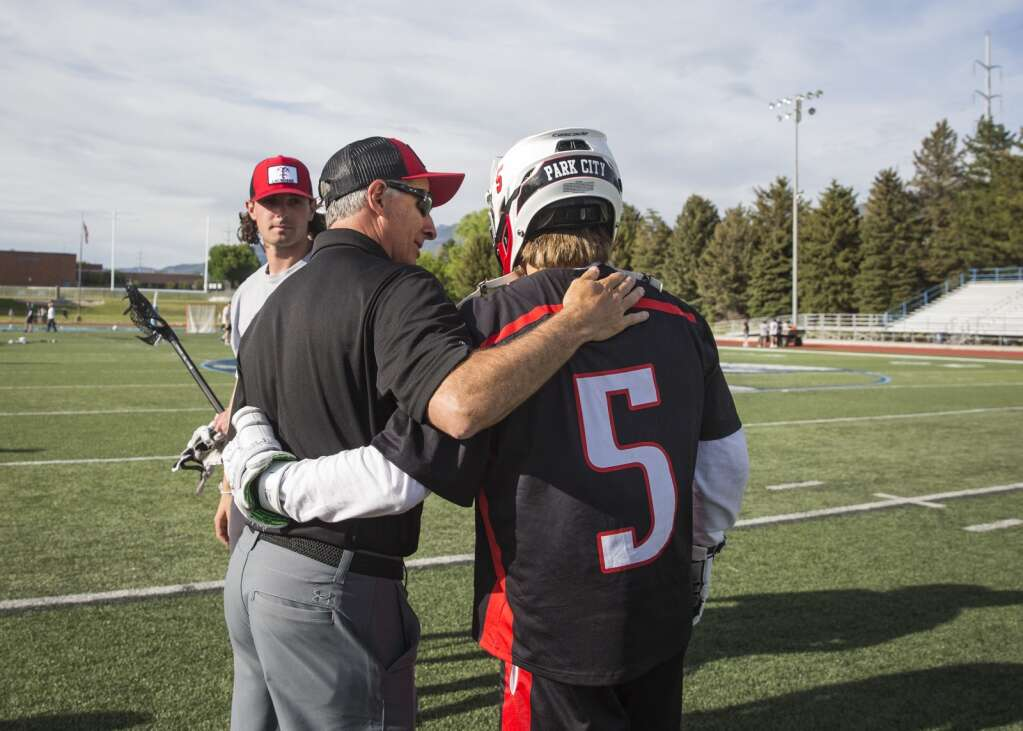 Park City High School boys varsity lacrosse head coach Mike Persky, left, comforts senior Bo Hawthorne following the Miners' 20-13 loss to Corner Canyon. (Tanzi Propst/Park Record)