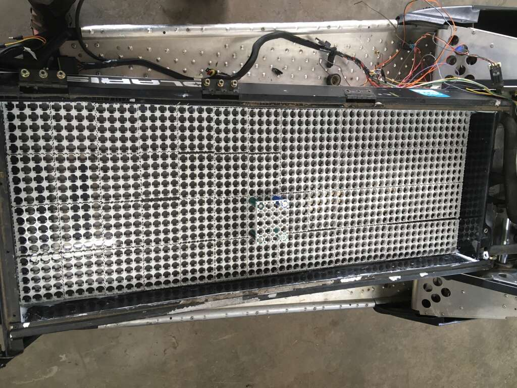 A look at the tool box and gas tank compartments on the snowmobile with the battery cell holders in place to see how many batteries the Hoffmans can install in this area for their electric snowmobile. Greg Hoffman said they will place 1,100 batteries here, and will need to get 300 more in the gas tank for 15,000 watts.