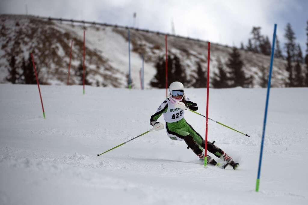 Summit High School Alpine ski team racer Victoria Uglyar navigates gates while skiing the slalom course during the Colorado High School State Alpine Ski Championships at Loveland Ski Area on March 12. | Photo by Jason Connolly / Jason Connolly Photography