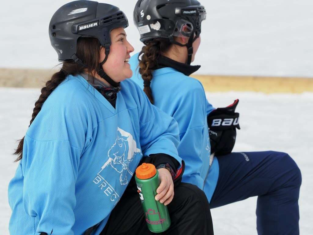 Members of the Pucking Critters women's championship pond hockey team take a water break during last weekend's Pabst Blue Ribbon Colorado Pond Hockey Tournament at North Pond Park in Silverthorne. | Photo by Elaine Collins