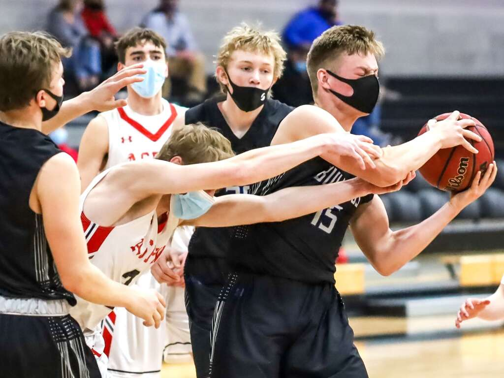 Moffat County's Ryan Peck battles for the ball against Aspen on Saturday, March 6, 2021, inside the AHS gymnasium. Aspen won, 68-42. Photo by Austin Colbert/The Aspen Times.