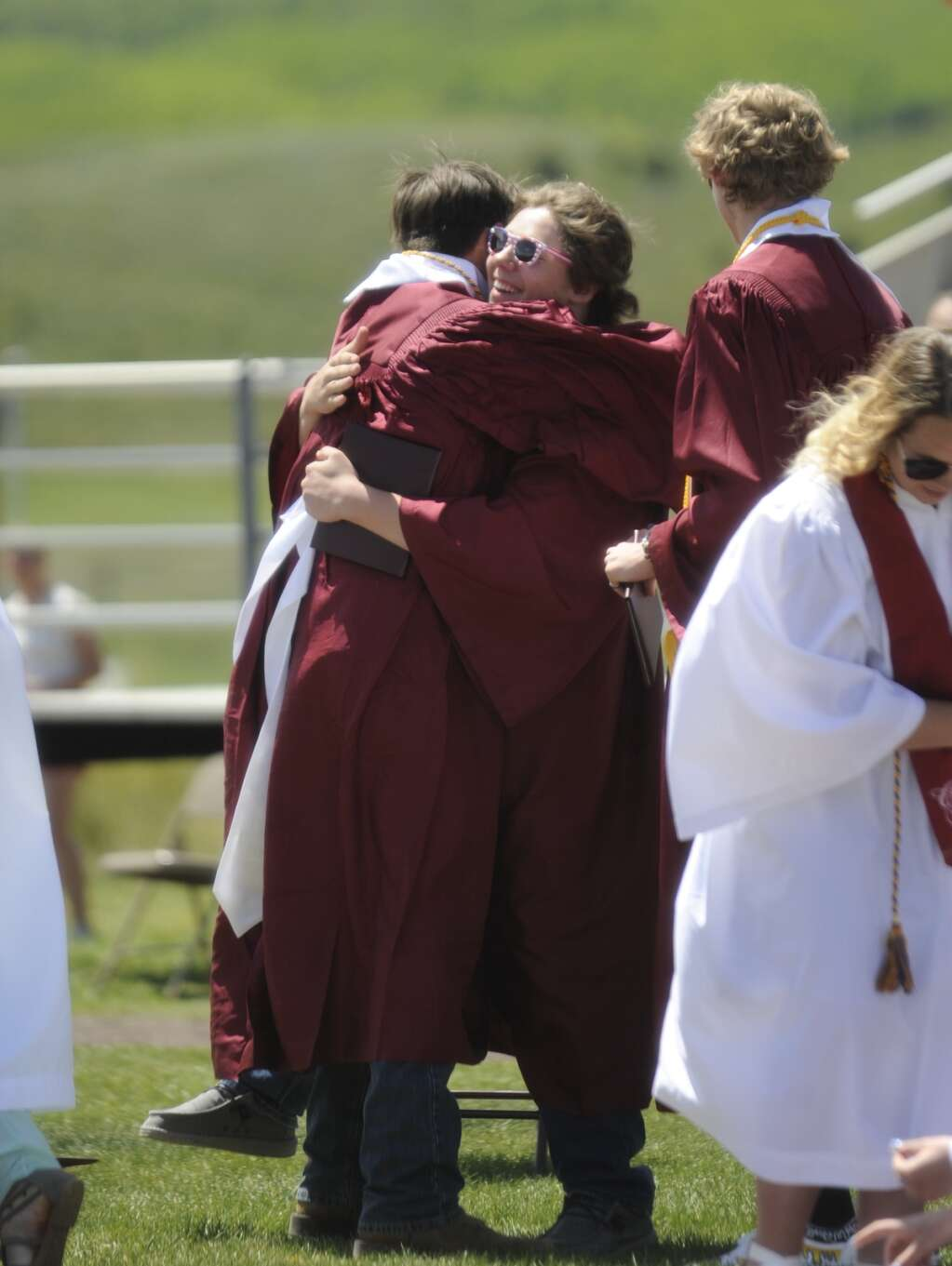 Chase de la Mater and Tyler Koler-Wixom hug after the Soroco High School graduation ceremony on Saturday morning.