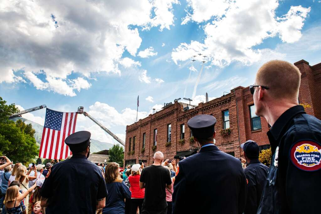 The Tiger Squadron flies over a crowd gathered for the 20th annual Day of Remembrance for 9/11 on East Hopkins in Aspen on Saturday, Sept. 11, 2021. (Kelsey Brunner/The Aspen Times)