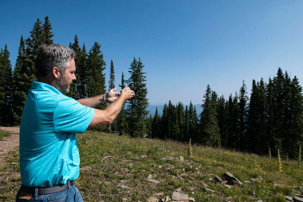 Mak Keeling points down the hill towards where the Pandora Lift is proposed on Aspen Mountain on Thursday, August 12, 2021. (Kelsey Brunner/The Aspen Times)