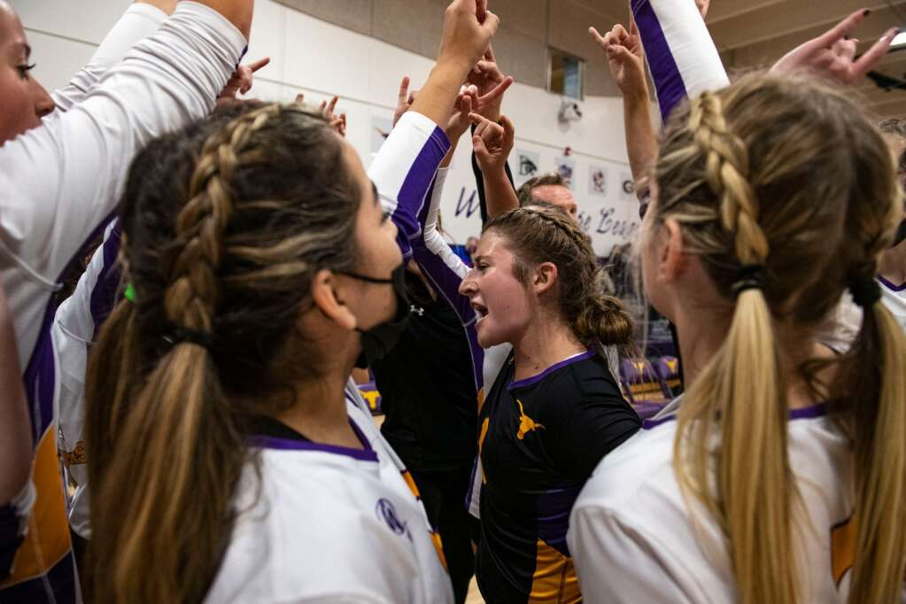 Basalt junior Karsyn Dombrowski leads the volleyball team in a cheer before the start of the game against Aspen High School in the Longhorns' gym on Thursday, Oct. 21, 2021.   Kelsey Brunner/The Aspen Times