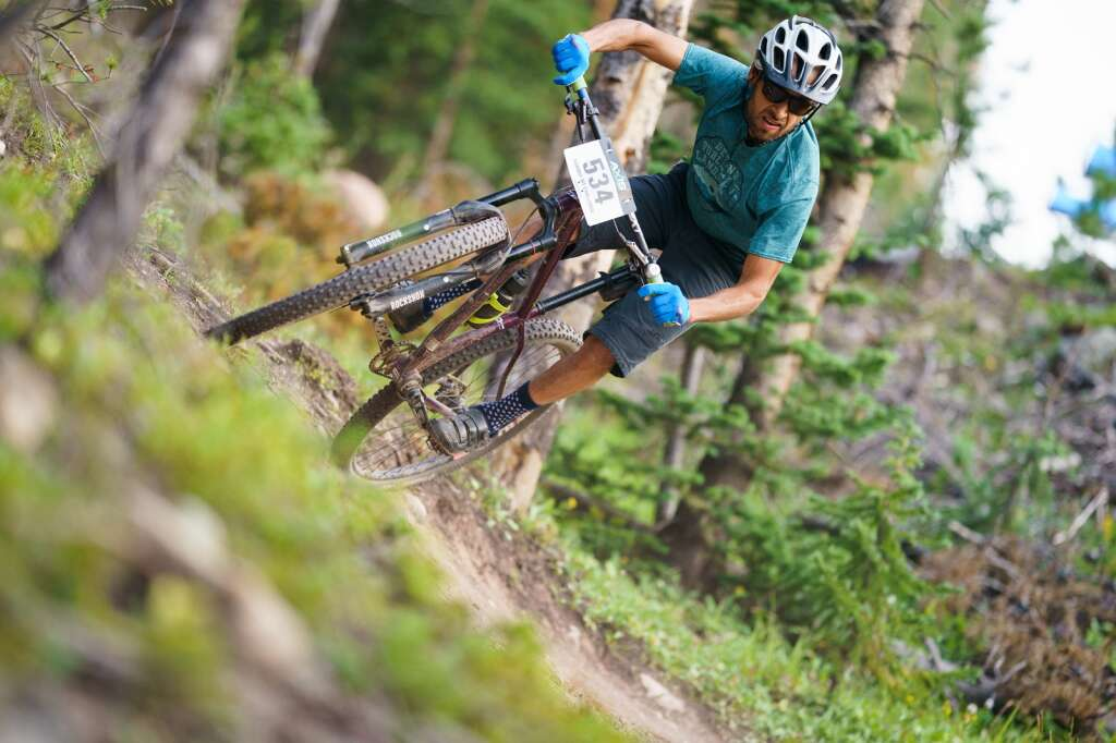 Singlespeed bike racer Bernie Romero takes the high line on his way to a second place finish at Wednesday's Copper Mountain Melee. | Photo by John Hanson