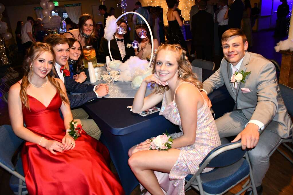 Students gather around a table at prom Saturday night. (Andy Bockelman / For Craig Press)
