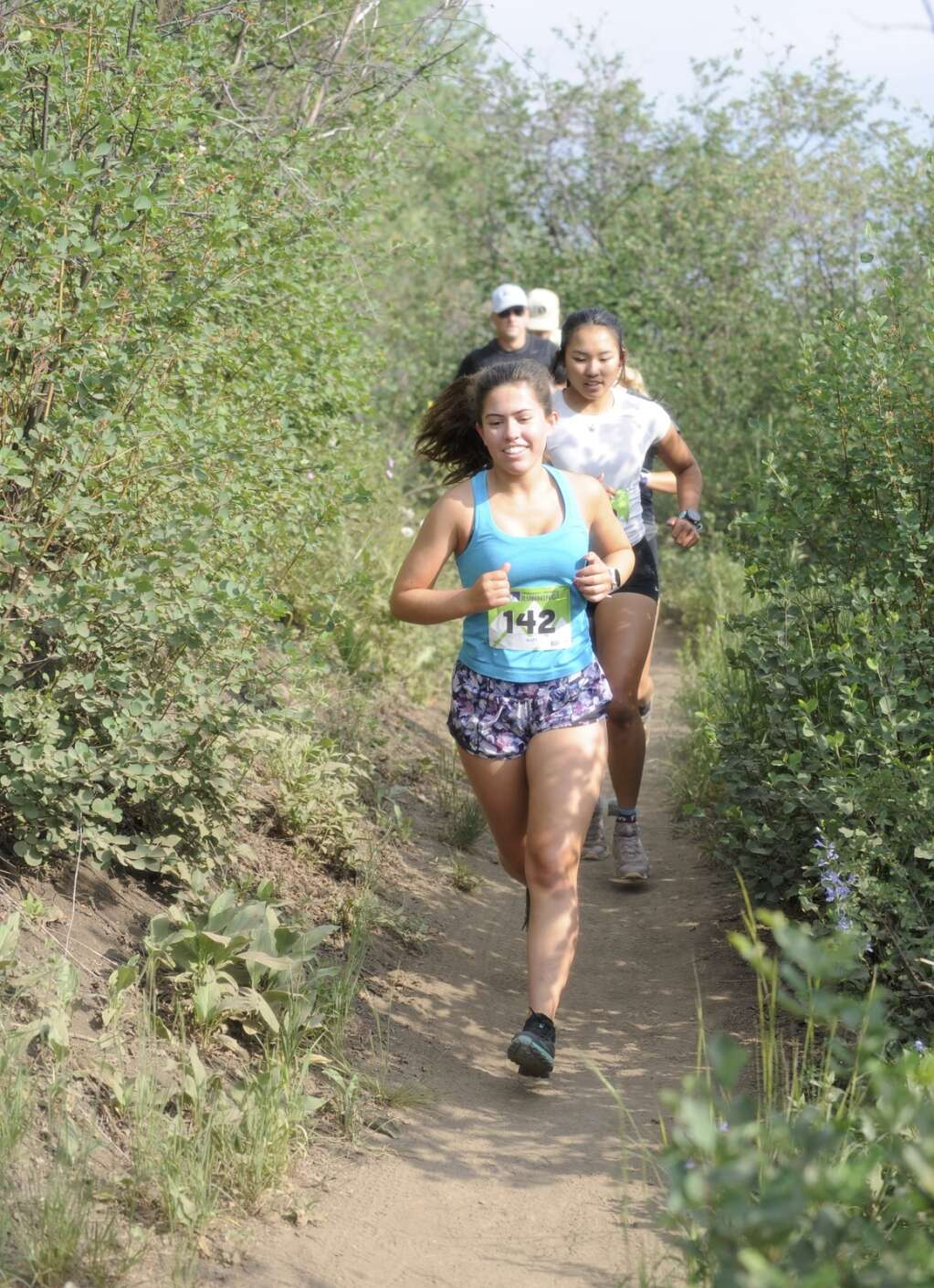 Suzy Magill smiles in the first mile of the Steamboat Springs Running Series Howelsen Hill Trail Run on Saturday morning. (Photo by Shelby Reardon)