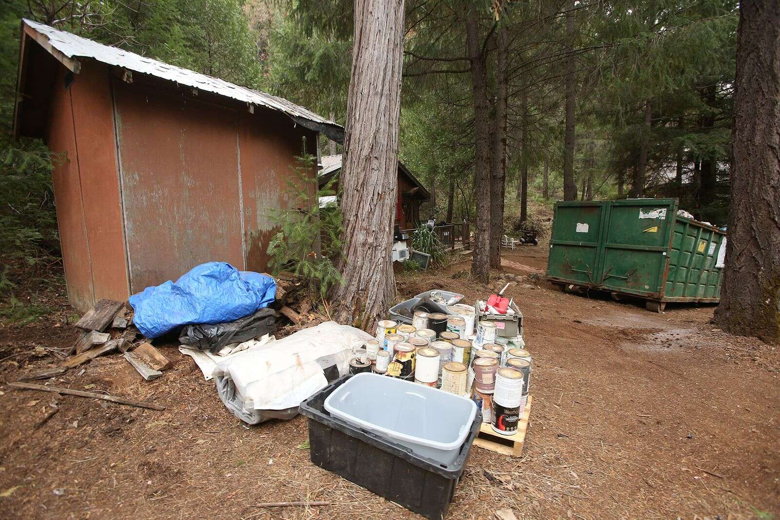 There is still some trash left to be taken care of on site including some hazardous waste, that was brought to the Marlowe's property by the squatters.   Photo: Elias Funez