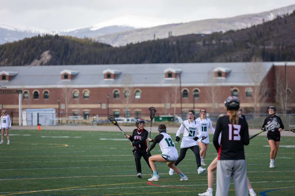 Katherine Costello defends during the Summit High School varsity girls lacrosse team's 14-4 loss to Eagle Valley at Summit High School in Breckenridge on Tuesday, May 11, 2021. | Photo by Lucas Herbert / Lucas Herbert Media